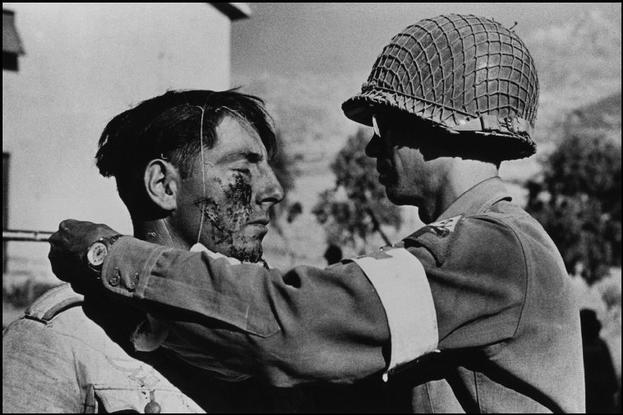 Robert Capa, Sicily. July-August 1943. An American medic looking after a German prisoner.